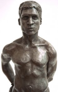 frontal view of bust of bronze sculpture of male nude standing figure