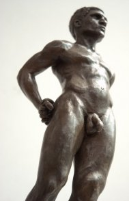 caudal frontal lateral view of bronze sculpture of male nude standing figure