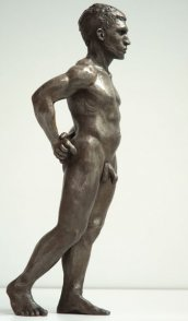 lateral view of bronze sculpture of male nude standing figure