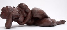 Bronze sculpture of a female nude resting on her elbow
