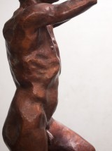 Bronze sculpture of a male nude standing on one leg